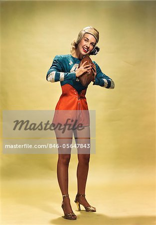 1940s - 1950s SMILING WOMAN PINUP WEARING FOOTBALL PLAYER UNIFORM COSTUME HOLDING FOOTBALL Stock Photo - Rights-Managed, Image code: 846-05647843