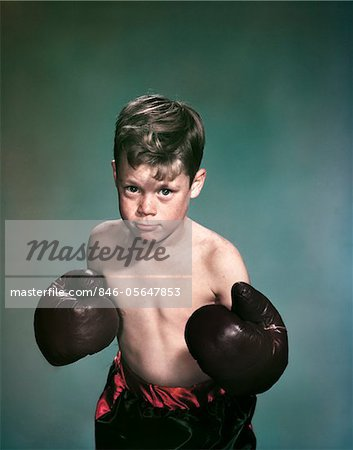 1940s - 1950s PORTRAIT BOY WEARING BOXING GLOVES AND TRUNKS Stock Photo - Rights-Managed, Image code: 846-05647853