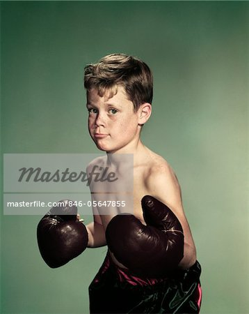 1940s - 1950s PORTRAIT BOY  WEARING BOXING GLOVES AND TRUNKS Stock Photo - Rights-Managed, Image code: 846-05647855