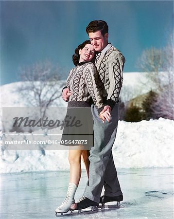 1940s - 1950s SMILING COUPLE ICE SKATING WEARING MATCHING SWEATERS Stock Photo - Rights-Managed, Image code: 846-05647873