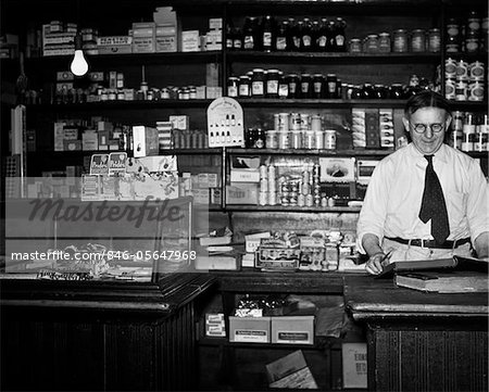 1930s GENERAL STORE INTERIOR GROCER OWNER BEHIND COUNTER Stock Photo - Rights-Managed, Image code: 846-05647968