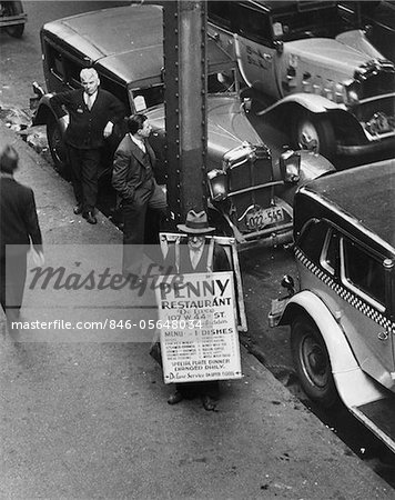 1930s NYC STREET DURING DEPRESSION WITH MAN WEARING SANDWICH BOARD ADVERTISING PENNY RESTAURANT Stock Photo - Rights-Managed, Image code: 846-05648034