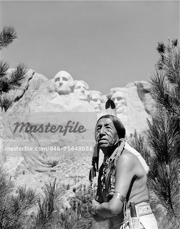 1960s PORTRAIT OF AMERICAN INDIAN IN FRONT OF MOUNT RUSHMORE Stock Photo - Rights-Managed, Image code: 846-05648058