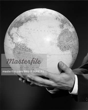 1960s MANS HAND HOLDING GLOBE OF THE WORLD Stock Photo - Rights-Managed, Image code: 846-05648191
