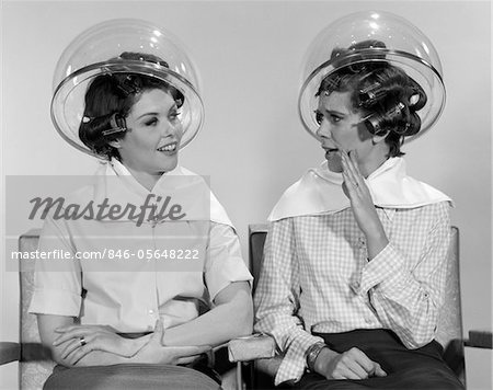 1960s TWO WOMEN SITTING TOGETHER GOSSIPING UNDER HAIRDRESSER HAIR DRYER Stock Photo - Rights-Managed, Image code: 846-05648222