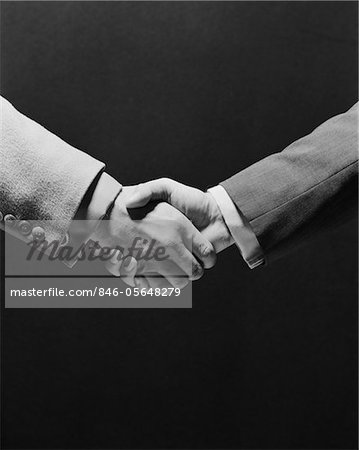 1970s TWO BUSINESSMEN SHAKING HANDS Stock Photo - Rights-Managed, Image code: 846-05648279
