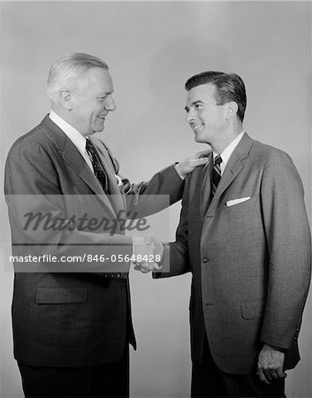 1950s OLDER AND YOUNGER BUSINESS MEN SHAKING HANDS Stock Photo - Rights-Managed, Image code: 846-05648428