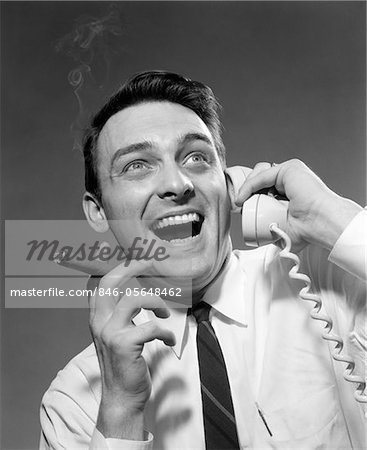 1950s - 1960s EXCITED MAN TALKING ON TELEPHONE GRINNING SMOKING CIGAR INDOOR Stock Photo - Rights-Managed, Image code: 846-05648462