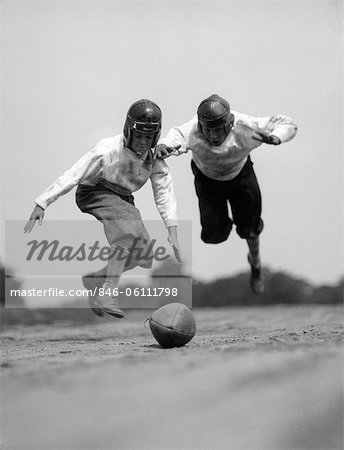 1930s PAIR OF BOYS IN KNICKERS & LEATHER HELMETS RACING TO DIVE ON FOOTBALL Stock Photo - Rights-Managed, Image code: 846-06111798