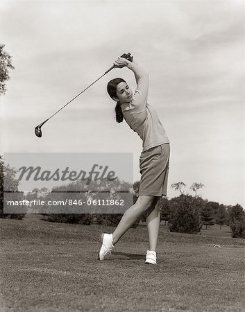 1960s WOMAN PLAYING GOLF TEEING OFF GOLF BALL FROM TEE WITH DRIVER SUMMER OUTDOOR Stock Photo - Rights-Managed, Image code: 846-06111862