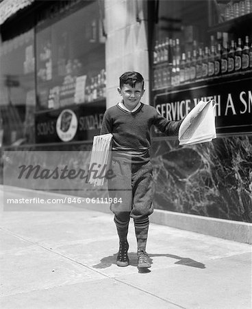 1930s NEWSBOY IN KNICKERS WALKING DOWN STREET HAWKING PAPERS Stock Photo - Rights-Managed, Image code: 846-06111984