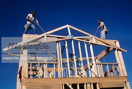 1980s BUILDING A NEW HOUSE WITH LUMBER RAISING THE  A-FRAME FOR THE ROOF LINE Stock Photo - Rights-Managed, Image code: 846-06112019