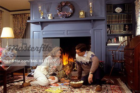 FAMILY SITTING BY FIREPLACE Stock Photo - Rights-Managed, Image code: 846-06112077