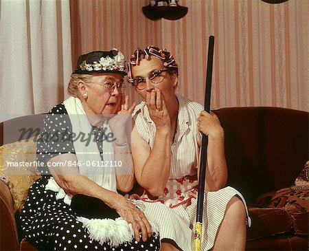 1960s TWO SENIOR OLDER WOMEN SITTING ON SOFA GOSSIPING Stock Photo - Rights-Managed, Image code: 846-06112110