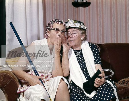 1960s TWO SENIOR OLDER WOMEN SITTING ON SOFA GOSSIPING Stock Photo - Rights-Managed, Image code: 846-06112111