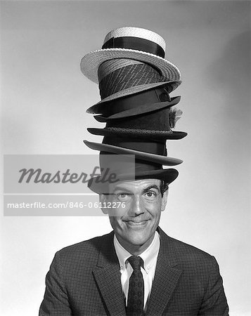 1950s PORTRAIT OF MAN LOOKING AT CAMERA WEARING 6 HATS Stock Photo - Rights-Managed, Image code: 846-06112276
