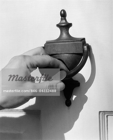 1930s MAN'S HAND LIFTING DOOR KNOCKER Stock Photo - Rights-Managed, Image code: 846-06112488