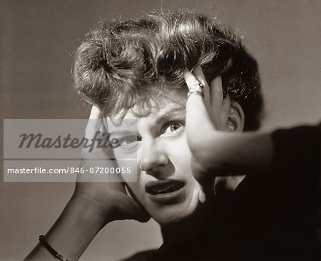 1950s SCARED FRIGHTENED WOMAN WITH HANDS TO HEAD Stock Photo - Rights-Managed, Image code: 846-07200055