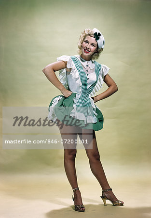 1940s 1950s PORTRAIT SMILING BLOND WOMAN PINUP WEARING GREEN CHECKED WAITRESS UNIFORM AND HAT WITH SHAMROCK LOOKING AT CAMERA Stock Photo - Rights-Managed, Image code: 846-07200101