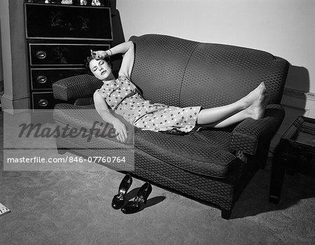 [Image: 846-07760764em-1950s-TIRED-WOMAN-LYING-O...ESTING.jpg]