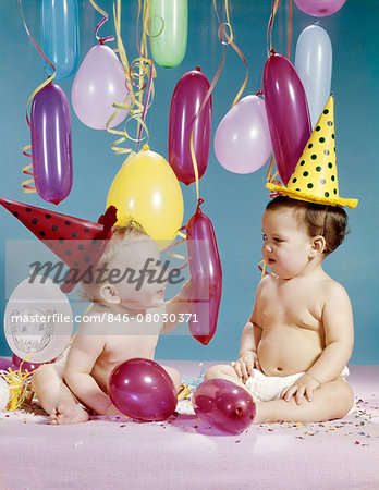 1960s TWO BABY GIRLS WEARING PARTY HATS WITHBALLOONS Stock Photo - Rights-Managed, Image code: 846-08030371