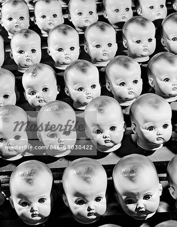 1950s ROWS OF BABY DOLL HEADS IN PRODUCTION LINE Stock Photo - Rights-Managed, Image code: 846-08030422