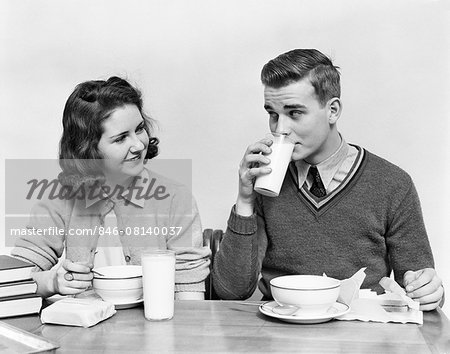 """1940s TEENAGE GIRL AND BOY EATING SCHOOL LUNCH SOUP SANDWICHES TOGETHER BOY DRINKING MILK Stock Photo - Rights-Managed, Image code: 846-08140037"