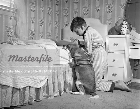 1950s BOY & DOG PRAYING AT BEDSIDE Stock Photo - Rights-Managed, Image code: 846-08140047