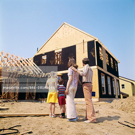 1970s FAMILY OF FOUR MAN WOMAN BOY GIRL LOOKING AT NEW HOME UNDER CONSTRUCTION Stock Photo - Rights-Managed, Image code: 846-08140066
