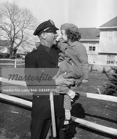 1950s POLICEMAN CARRYING YOUNG GIRL Stock Photo - Rights-Managed, Image code: 846-08140100