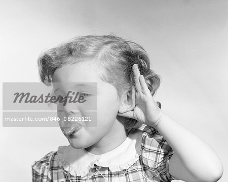 1950s LITTLE GIRL MAKING RUDE GESTURE STICKING OUT TONGUE CUPPING HAND ON EAR Stock Photo - Rights-Managed, Image code: 846-08226121