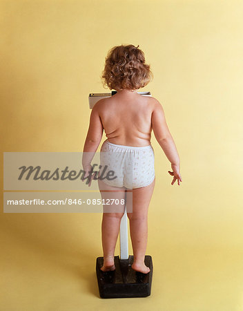 1970s OVERWEIGHT CHUBBY LITTLE GIRL WEIGHING HERSELF ON SCALE BACK VIEW WEARING ONLY PANTIES Stock Photo - Rights-Managed, Image code: 846-08512708