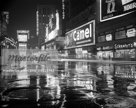 1950s WET RAINY STREETS OF TIMES SQUARE AT NIGHT NEON SIGNS ADVERTISING NEW YORK CITY NY USA Stock Photo - Rights-Managed, Image code: 846-08512742