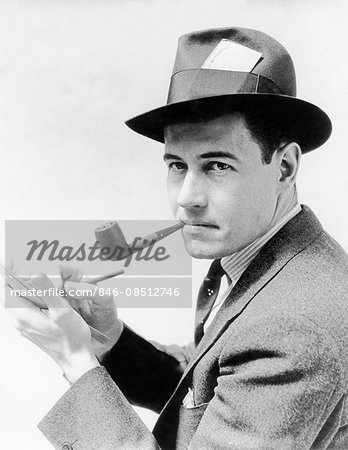 1930s 1940s MAN REPORTER WEARING HAT WITH PRESS PASS WRITING NOTES IN PAD TABLET SMOKING PIPE LOOKING AT CAMERA Stock Photo - Rights-Managed, Image code: 846-08512746