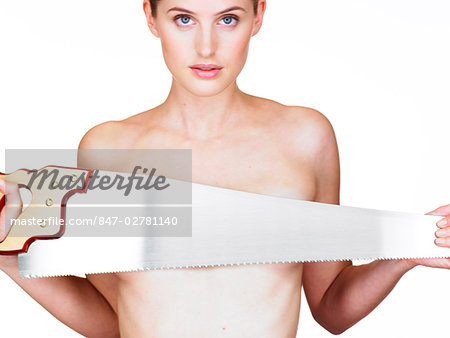 Landscape of girl with saw held across breasts Stock Photo - Rights-Managed, Image code: 847-02781140