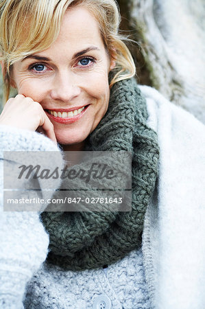 Portrait of happy, mature woman in cosy roll neck jumper Stock Photo - Rights-Managed, Image code: 847-02781643