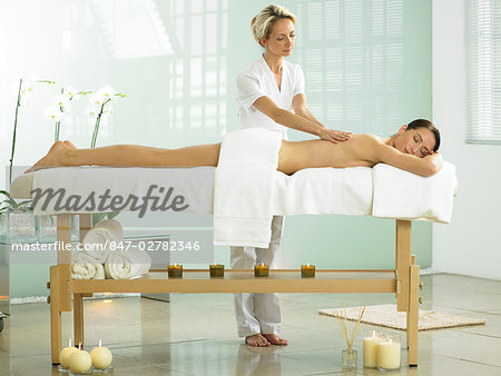 Full length of woman on spa massage bed with therapist Stock Photo - Rights-Managed, Image code: 847-02782346