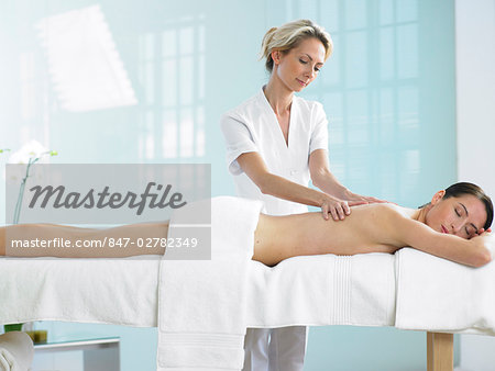 Cropped full length of woman on spa massage bed with therapist Stock Photo - Rights-Managed, Image code: 847-02782349