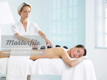 Cropped full length of woman having a stone massage Stock Photo - Rights-Managed, Image code: 847-02782362