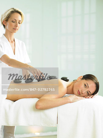Cropped full length of woman having a stone massage Stock Photo - Rights-Managed, Image code: 847-02782365