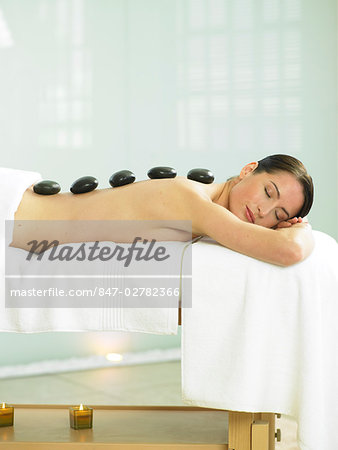 Cropped full length of woman having a stone massage Stock Photo - Rights-Managed, Image code: 847-02782366