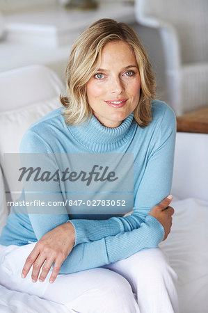 Beautiful mature female wearing blue jumper in beachhouse Stock Photo - Rights-Managed, Image code: 847-02783052
