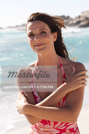 Beautiful mature lady walking on the beach Stock Photo - Rights-Managed, Image code: 847-02786386