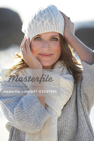 Beautiful mature lady walking on the beach Stock Photo - Rights-Managed, Image code: 847-03067986