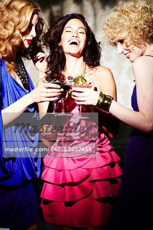 Three young women enjoying cocktails Stock Photo - Rights-Managed, Image code: 847-03227455
