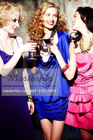 Three young women enjoying cocktails Stock Photo - Rights-Managed, Image code: 847-03227459