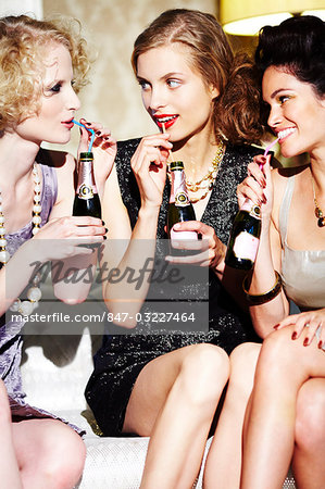 Three young women enjoying champagne Stock Photo - Rights-Managed, Image code: 847-03227464