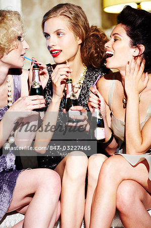 Three young women enjoying champagne Stock Photo - Rights-Managed, Image code: 847-03227465