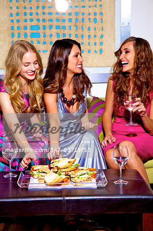 Three beautiful women chatting with food and wine Stock Photo - Rights-Managed, Image code: 847-03719753