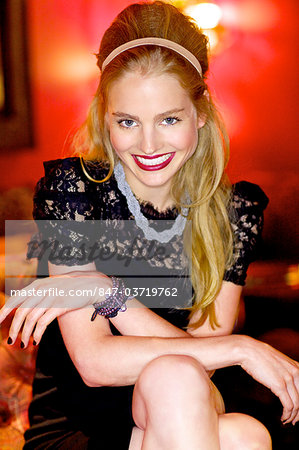 Blonde in black lace dress in a bar Stock Photo - Rights-Managed, Image code: 847-03719762